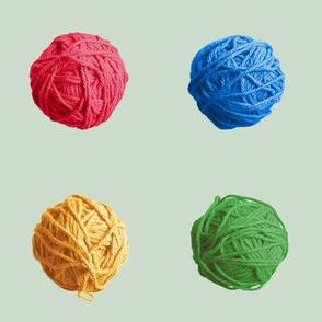 little yarn balls - red, blue, green, yellow