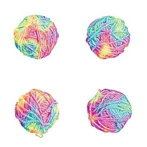little tie-dyed rainbow yarn balls on white