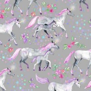 Mom and baby unicorns with pink and purple manes and tails on grey