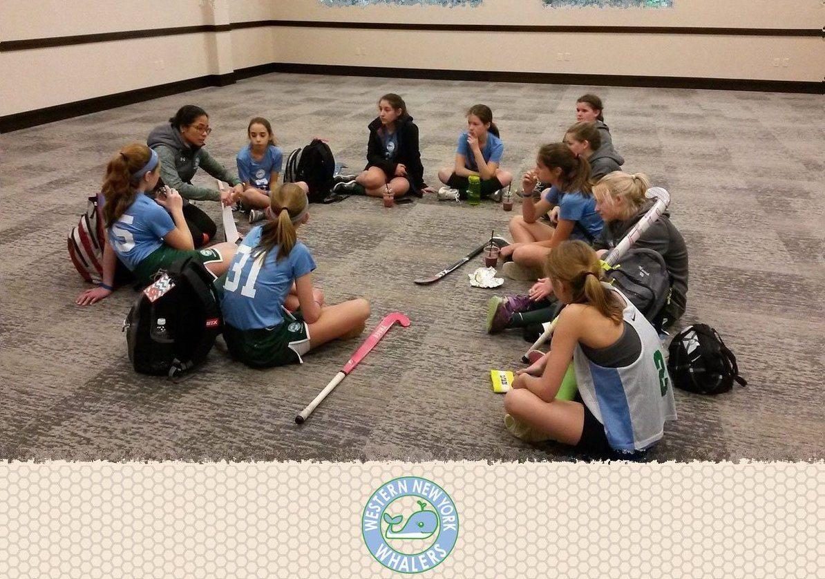 wny whalers sitting in a circle
