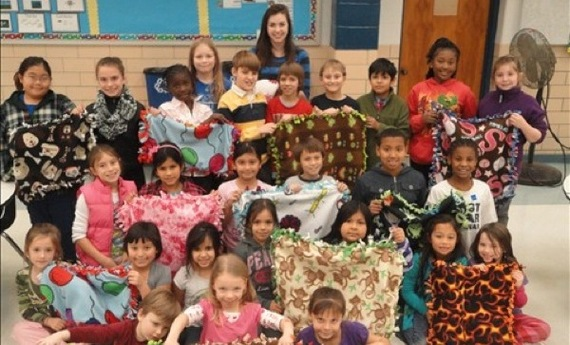 Children making blankets for children and animals in need