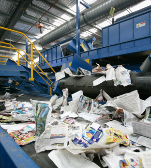 Newspapers in recycling centre