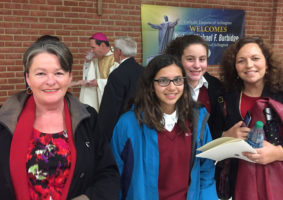 Mrs. Rowley and students at Bishop's Installation Mass