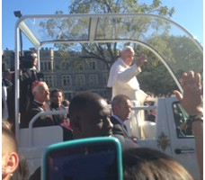 Porp Francis waving from popemobile