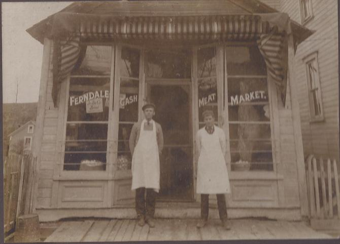 Ferndale Meat Market, believed to be 436-438 Ferndale Avenue prior to 1924. Johnstown Baking Co. sign in the window at left. Side of beef in right window. Marie Hiner donated this photo.