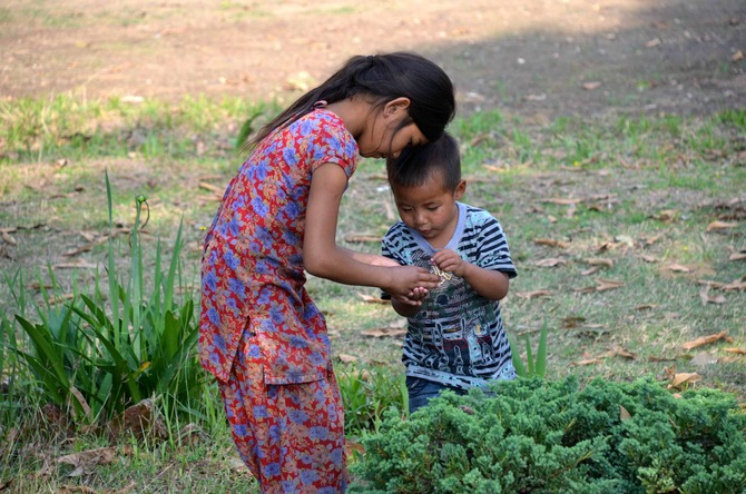 Binita gives Manoj - the youngest addition to Bhimpedi - a tour of the garden.