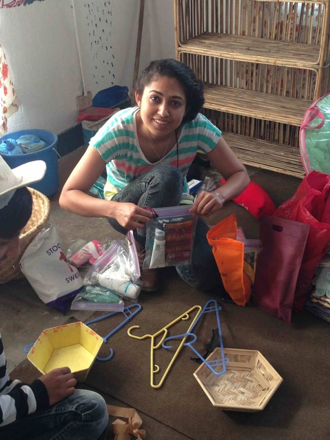 Sumee helping sort donations from foreign volunteers and travelers.