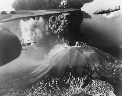 447th Squadron B-25s fly past erupting Vesuvius