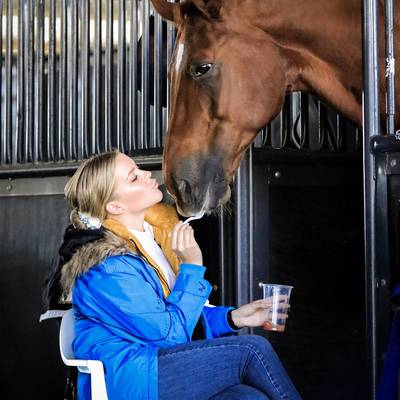 LUXOR 118 (DE) - with Kate Farrell, sharing a well deserved treat after a super ride.  2019 NSW Dressage Championships
