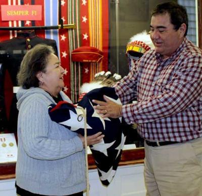 Osage Congressman Geoffrey Standing Bear donates flag to OTM