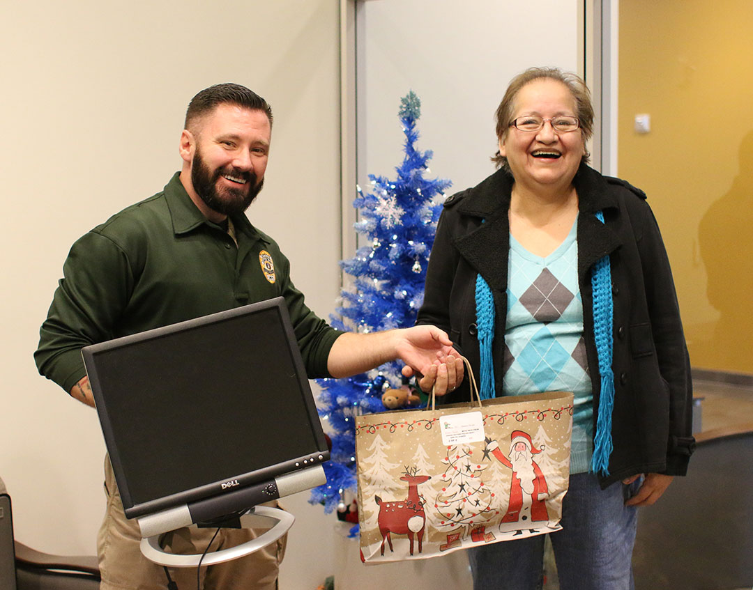 Fourteen Osage families receive free refurbished Dell computers for Christmas