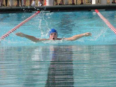 Ten-year-old Osage swimmer competes in swim meet for young teens
