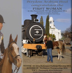 Strydom congratulates the First Woman...