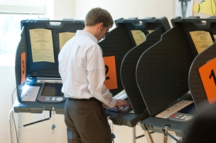 A voter casts a ballot in Travis County on November 2, 2010.
