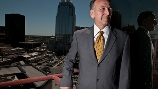 Texas Workers' Compensation Commissioner Rod Bordelon poses on a balcony of the William P. Hobby Jr. Building in downtown Austin.