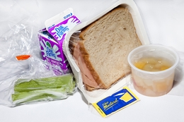 The Summer Food Program began Monday, June 7, 2010. This meal, served at the Austin Boys and Girls Club South, consisted of a half-pint of milk, a ham sandwich on wheat bread with mustard, celery and an assorted fruit cup.