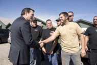 U.S. Sen. Ted Cruz, R-Texas, l, shakes hands with LaRue Tactical employees at his arrival Feb. 19, 2013 at their Leander plant.