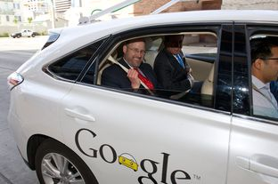 Texas Department of Transportation Executive Director Phil Wilson gets a ride in a Google self-driving car on Feb. 19, 2013, in front of the Hilton Austin.
