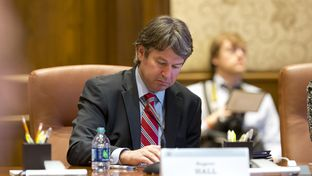Dallas businessman Wallace Hall, Jr. takes notes at the University of Texas Board of Regents meeting on Feb. 14, 2013 in Austin.