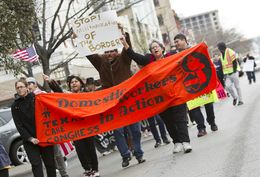 Large group for immigration reform rallies down Congress Ave. towards the Texas Capitol on February 22nd, 2013