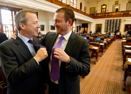 Rep. Ron Simmons R-Carrollton and Rep. Oscar Longoria D-Mission show off their purple ties on Purple Thursday at the Texas Capitol.