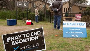 Several volunteers pray outside a South Austin clinic where abortions are performed as part of the pro-life campaign 40 Days for Life
