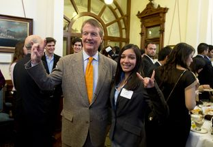 "UT President Bill Powers does the ""Hook-em 'Horns"" with student Lariza Uribe at the Texas Capitol on Mar. 5, 2013."