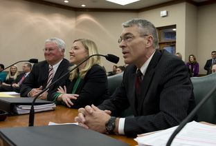 DPS chief Steve McCraw, r, Ken Armbrister, l, and Brandy Marty of the Governor's Office announce the access policy change to the Governor's Mansion on March 5, 2013.
