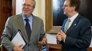 Former Florida Governor and potential 2016 presidential candidate Jeb Bush visits the Texas Capitol to discuss education initiatives in the Senate chamber. At right is Sen. Dan Patrick.