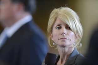 Sen. Wendy Davis, D-Fort Worth, pauses while voicing her objections to SB 1 the state budget bill on March 20, 2013.
