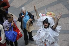 "An environmentalist dressed as a ""bag monster"" protests HB 2416 on March 20, 2013 by State Rep. Drew Springer, R-Muenster, banning local bag ordinances."