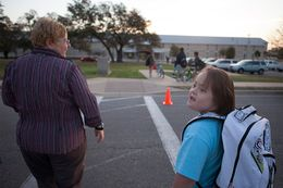 Stacy Ford taking her daughter, Aurora, who is 11 years old and has Down's Syndrome, to school on Tuesday, March 19, 2013.