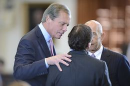 Lt. Gov. David Dewhurst confers with Sen. Kevin Eltife, R-Tyler, and Sen. Johnn Whitmire, D-Houston, on March 25, 2013 during debate on SB 7 a Medicaid reform bill.
