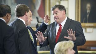 Sen Tommy Williams, R-The Woodlands, negotiates with a group of Senators including Sen. John Whitmire, D-Houston on SB 213 a prison healthcare measure on April 2, 2013.