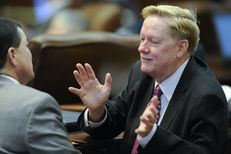 State Rep. Jim Pitts, R-Waxahachie, talks about HB 1 to a colleague on April 3, 2013.