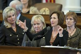 State Rep. Lois Kolkhorst, R-Brenham, explains Medicaid reimbursements from the front mike while debating SB 1 on April 4, 2013.