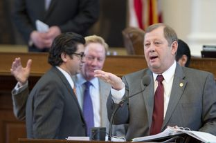 Statte Rep. John Otto, R-Dayton, explains an education funding amendment to SB 1 while House sponsor Chairman Jim Pitts, R-Waxahachie, talks with state Rep. Eddie Rodriguez, D-Austin, on April 4, 2013.