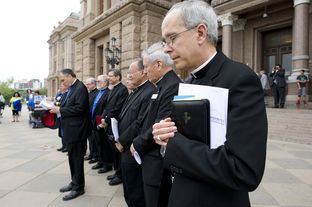 Texas Catholic bishops along with Cardinal Daniel DiNardo of Houston, l, pray on the South Steps of the Capitol on April 9, 2013.