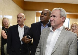 Senators John Whitmire, D-Houston, l, and Rodney Ellis, D-Houston, congratulate Michael Morton, r, at the court hearing in Georgetown on April 19, 2013.