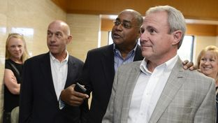 Senators John Whitmire, D-Houston, left, and Rodney Ellis, D-Houston, congratulate Michael Morton, right, at a court hearing in Georgetown on April 19, 2013. That day, a judge issued an arrest warrant for former Williamson County District Attorney Ken Anderson, after finding probable cause to believe Anderson withheld critical evidence in Michael Morton's 1987 murder trial.
