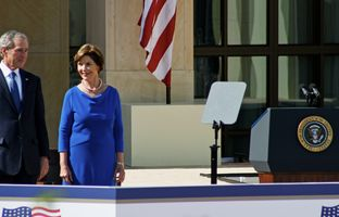 Former President George W. Bush with former First Lady Laura Bush in front of the Bush Center in Dallas at it's dedication April 25, 2013.