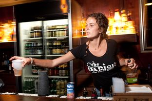 Lindsey Sunflower serves drinks at The Parish, a popular music venue in Austin, Texas. State Rep. Mark Strama is pursuing a bill that would cut the tax on mixed beverages charged to bars if they prove they are using the savings to present live music.