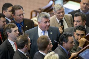 House sponsor State Rep. Allen Fletcher, R-Cypress, stands among House members during the consideration of a point of order on HB 972 a campus carry bill on May 4, 2013.