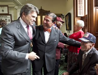 Gov. Perry along with his father Ray Perry and Sen. Eddie Lucio D-Brownsville on Senate floor where WW2 veterans were honored during a ceremony commemorating VE Day.