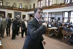 Gov. Rick Perry leaves the House chamber after speaking and visiting with members on May 13, 2013.