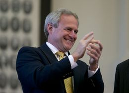Michael Morton cheers the unanimous passage of SB 825 in the Texas House on May 13, 2013.