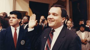 State Rep. John Carona holds up his right hand during his first swearing-in ceremony for the 72nd Legislature on January 8, 1991.