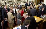 The Republican caucus meets in the Speaker's Committee Room before votes on budget bills on May 26, 2013.