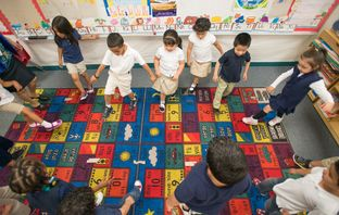 Pre-K students in Josefina Pineda's classroom do the hokey-pokey at the Dallas Independent School District elementary school, Cesar Chavez Learning Center in Dallas, Texas.