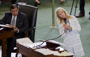 Sen. Wendy Davis, D-Ft. Worth, stretches while answering questions during her abortion bill filibuster on June 25, 2013.